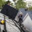 Pete Southerton (left) and Tom Bradshaw, of solar energy contractor Certasun, install solar panels on a Chicago home on May 17, 2021. Credit: Ashlee Rezin Garcia/Sun-Times