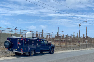The U.S. Army National Guard conducts fenceline testing for sulfur dioxide on May 10 at the Limetree Bay oil refinery in St. Croix, part of the U.S. Virgin Islands. Credit: Capt. Marcia Bruno/National Guard