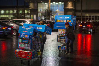 Shoppers walk on a Walmart parking lot after a pre-Black Friday shopping on Nov. 28, 2019 in Burbank, California. Credit: Apu Gomes via Getty Images