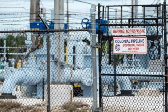 A sign is seen at Colonial Pipeline Baltimore Delivery in Baltimore, Maryland on May 10, 2021. Credit: Jim Watson/AFP via Getty Images