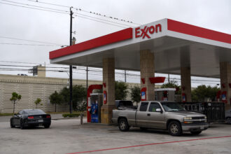 Vehicles refuel at an Exxon Mobil Corp. gas station in Houston, Texas, on Oct. 28, 2020. Credit: Callaghan O'Hare/Bloomberg via Getty Images