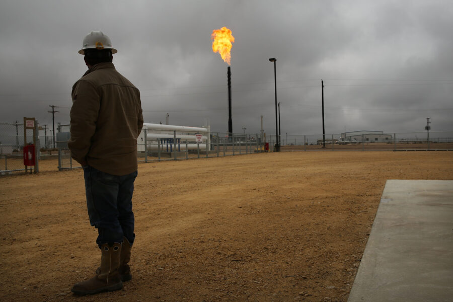 Flared natural gas is burned off at Apache Corporations operations at the Deadwood natural gas plant in the Permian Basin on Feb. 5, 2015 in Garden City, Texas. Credit: Spencer Platt/Getty Images