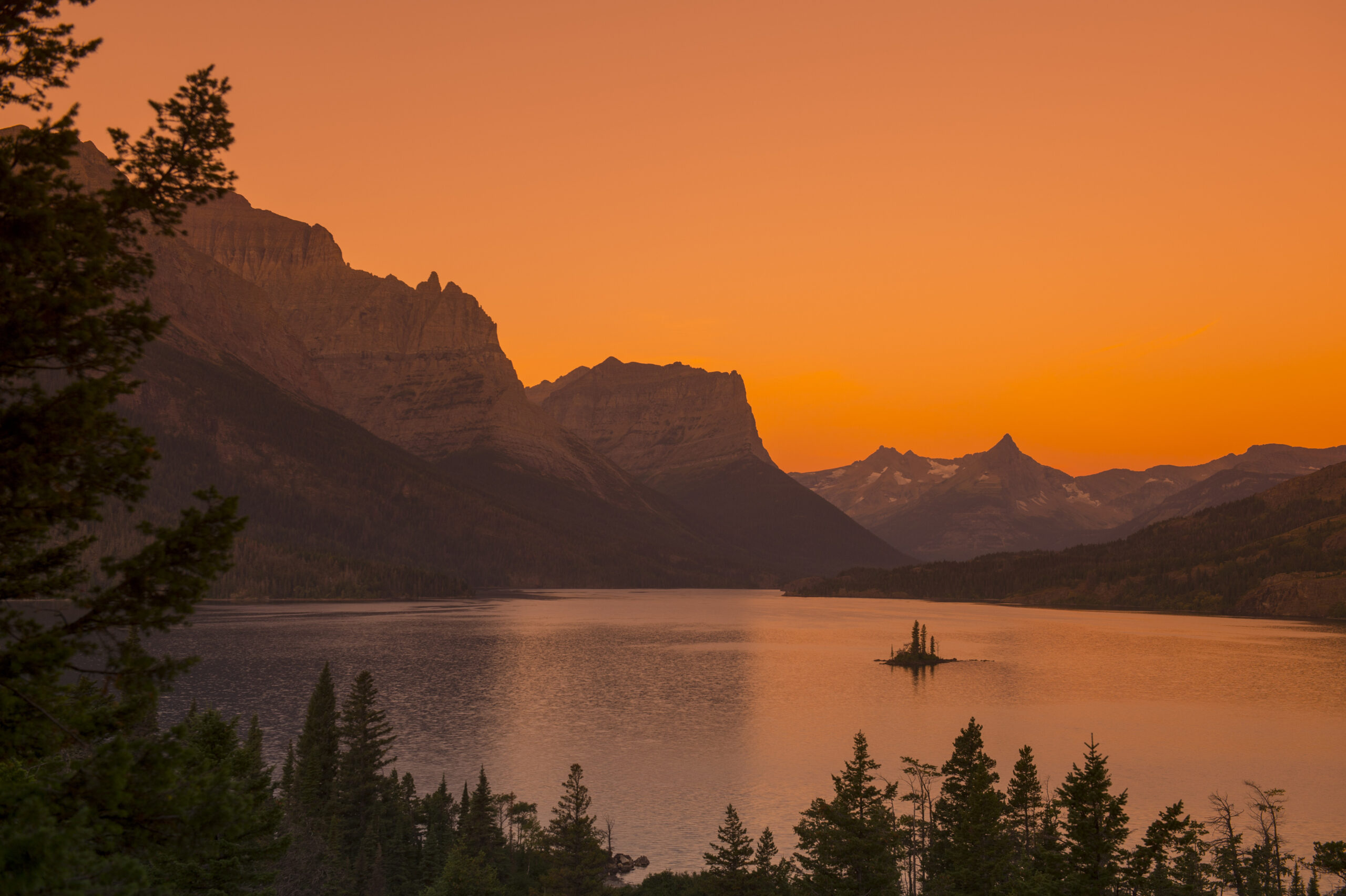 View of Wild Goose Island in Saint Mary Lake at sunrise in Glacier National Park, Montana, United States. Credit: Wolfgang Kaehler/LightRocket via Getty Images