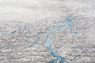 Melt water on the Greenland ice sheet. Credit: Education Images/Universal Images Group via Getty Images