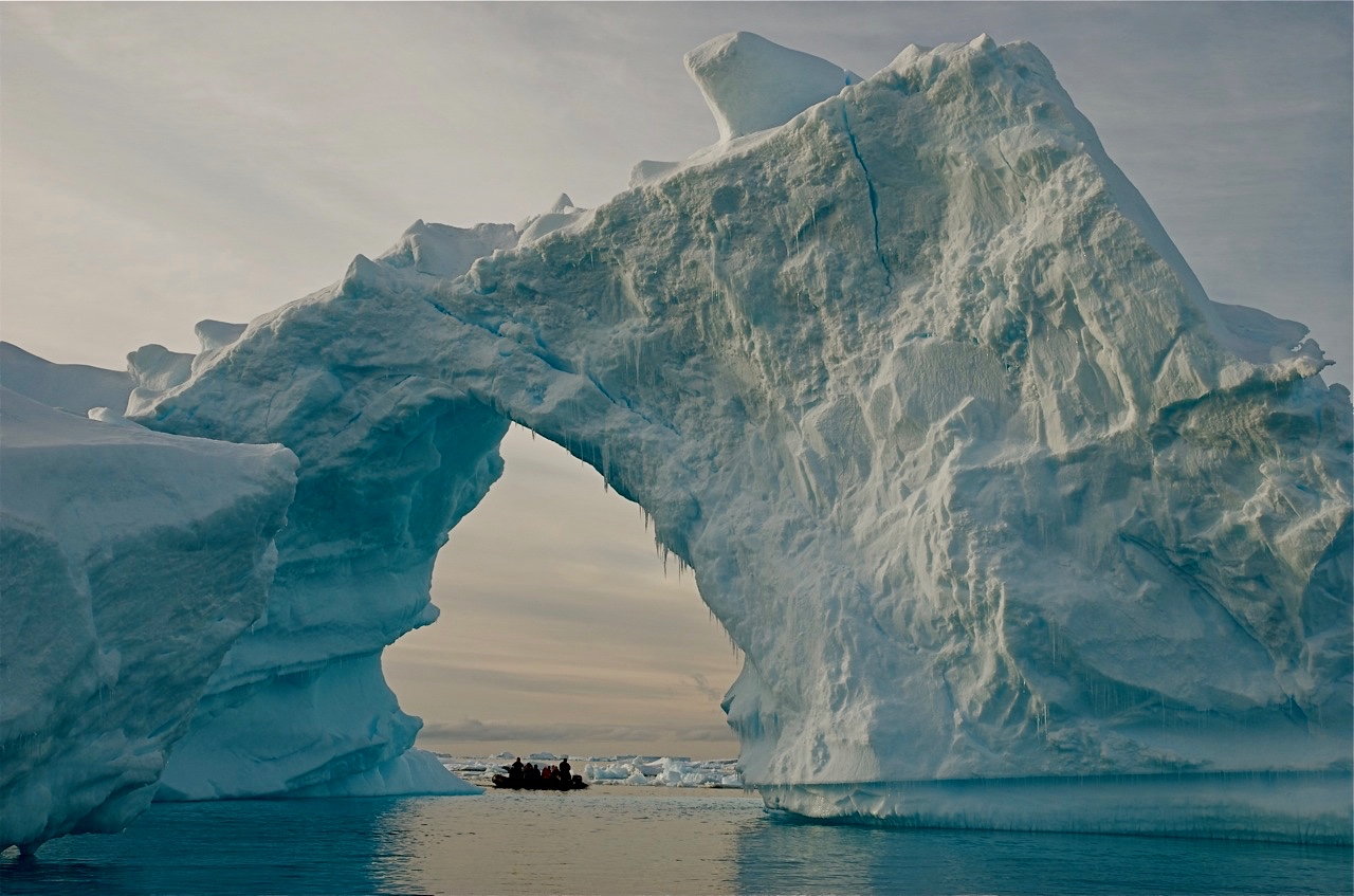 Researchers and tourists explore the edge of an ice shelf along the Antarctic Peninsula, which has warmed faster than nearly any other region in the past few decades. Credit: Bob Berwyn