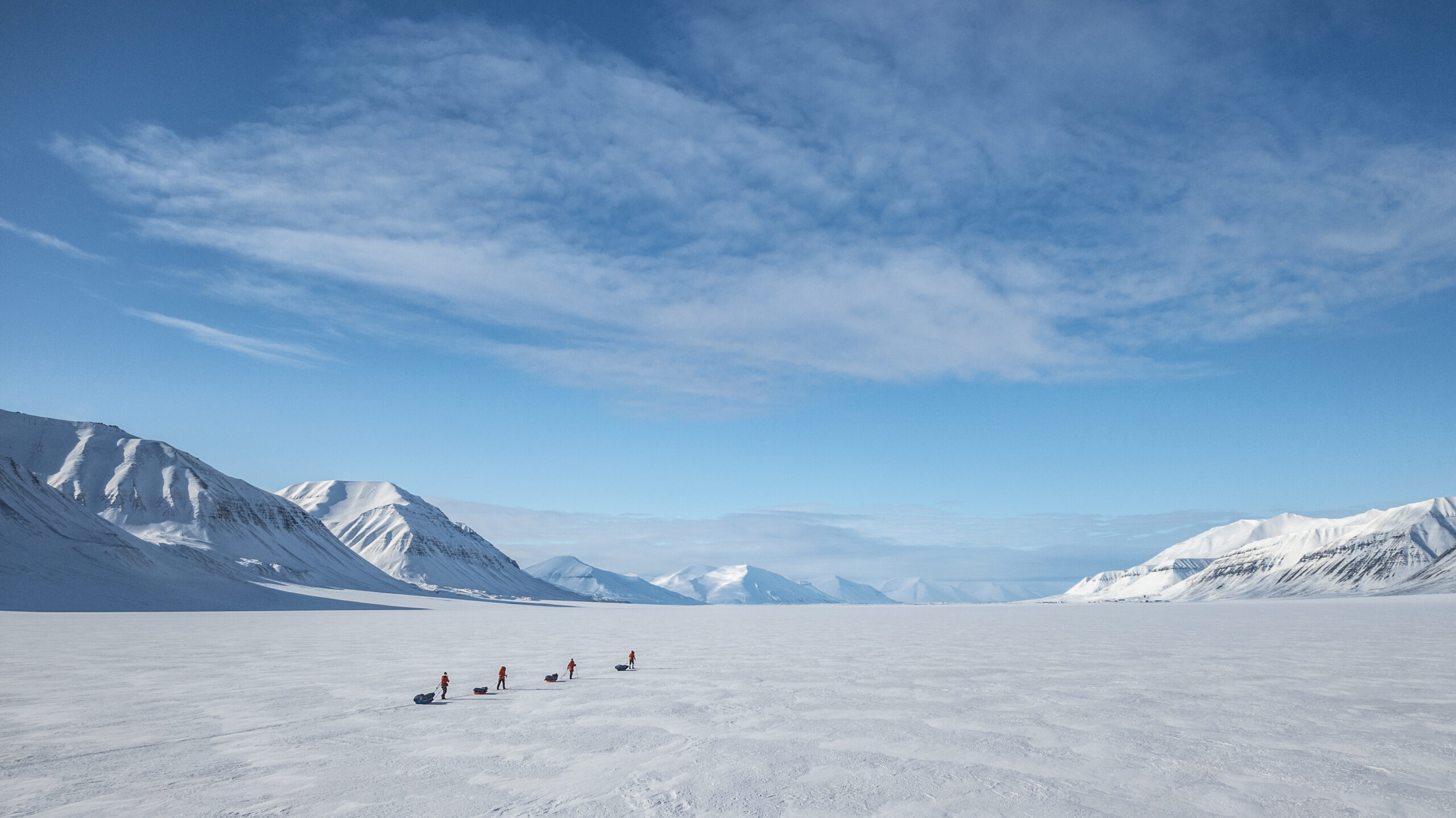 The Climate Sentinels team of female scientists ski Kfjellströmdalen, a 25-kilometer-long valley in Nordenskiöldland, Svalbard. The team traversed Svalbard's Spitsbergen Island to sample the snow and study the effects of black carbon on the Arctic island. Credit: Heïdi Sevestre