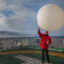 Juergen Graeser launches a weather balloon on the helicopter deck of Polarstern research vessel in 2019. Credit: Esther Horvath