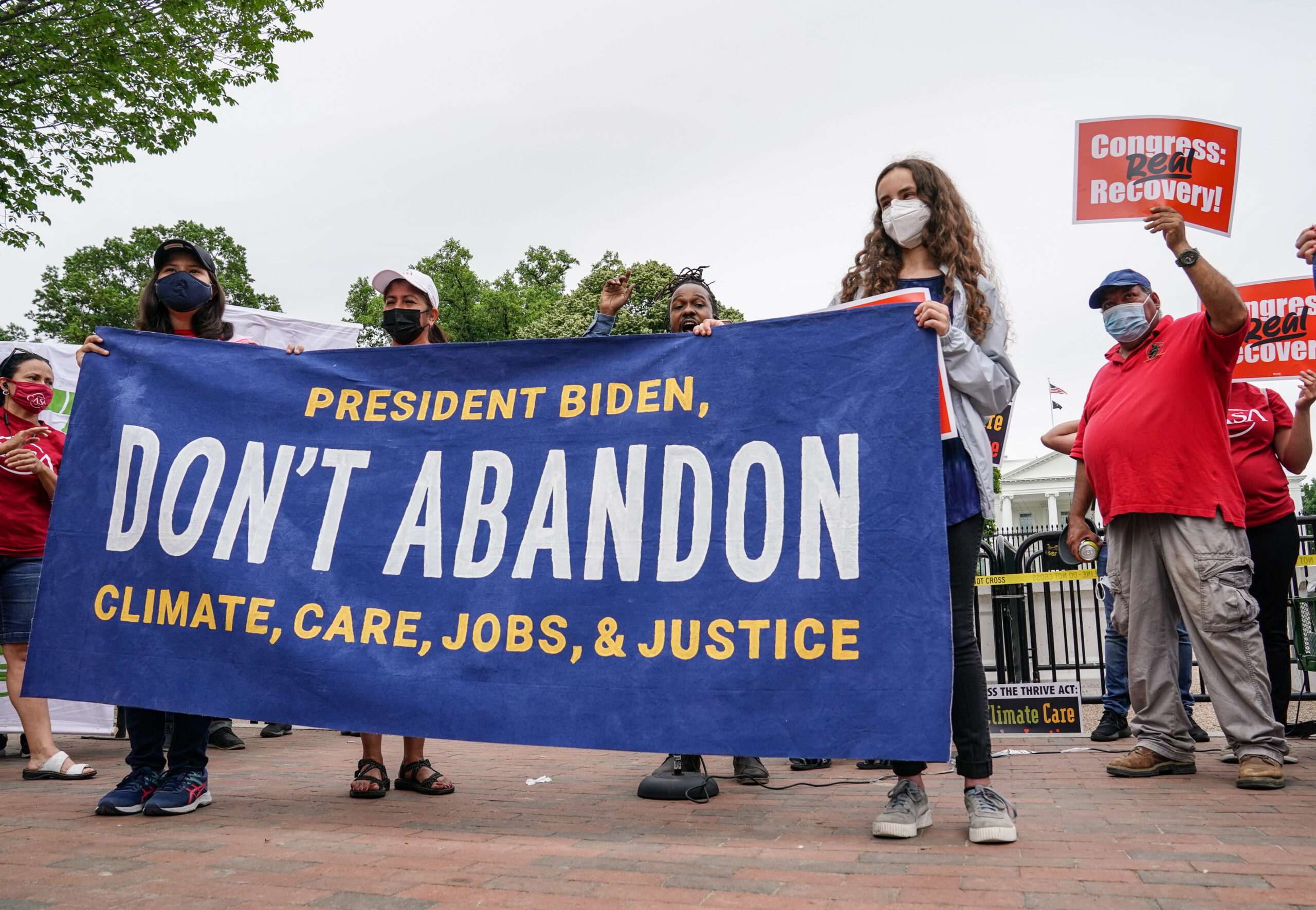 Activists gathered outside the White House in May to demand that President Joe Biden refuse to compromise on election promises regarding climate change and social justice. (Credit: Jemal Countess/Getty Images for Green New Deal Network)