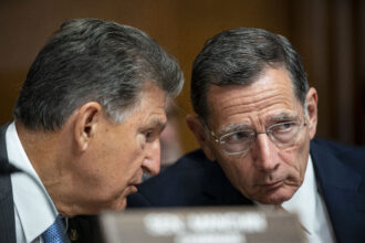 Senator Joe Manchin, a Democrat from West Virginia and chairman of the Senate Energy and Natural Resources Committee, left, speaks with Senator John Barrasso, a Republican from Wyoming and ranking member of the Senate Energy and Natural Resources Committee, during a hearing on Capitol Hill in Washington, D.C., U.S., on Tuesday, June 8, 2021. Democratic congressional leaders face a narrowing path to move forward on President Joe Biden's $4 trillion economic agenda without Republican support as negotiations with the GOP are at risk of stalling. Credit: Al Drago/Bloomberg via Getty Images
