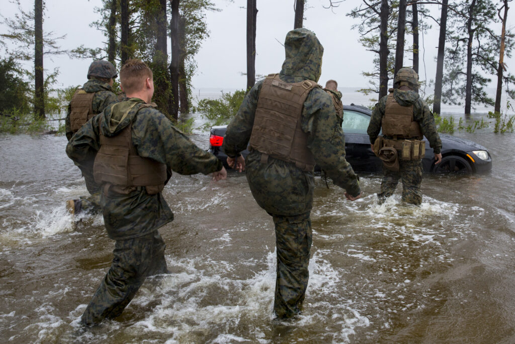 Marines with Marine Corps Base Camp Lejeune help push a car out of a flooded area during Hurricane Florence, on Marine Corps Base Camp Lejeune, Sept. 15, 2018. Hurricane Florence impacted MCB Camp Lejeune and Marine Corps Air Station New River with periods of strong winds, heavy rains, flooding of urban and low lying areas, flash floods and coastal storm surges. Credit: U.S. Marine Corps/Lance Cpl. Isaiah Gomez