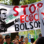 Activists hold up a banner of Jair Bolsonaro as they gather in front of the Brazilian Embassy during a demonstration organized by Extinction Rebellion activists on Aug. 26, 2019 in Brussels, Belgium. Credit: Thierry Monasse/Getty Images