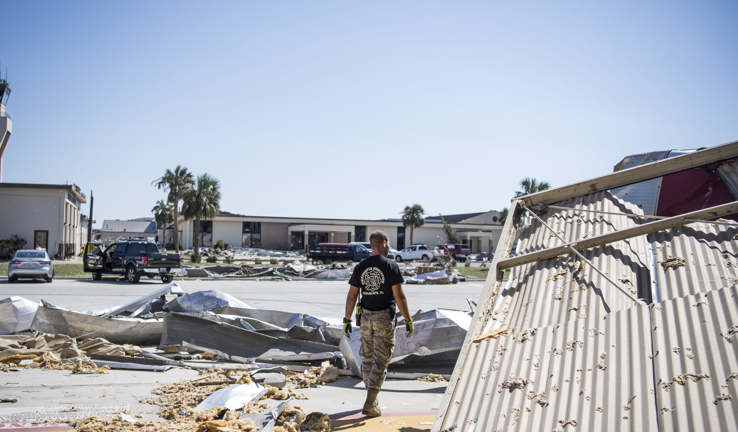 A Member of the 325th Civil Engineer Squadron begins the clean up process around their squadron on Tyndall Air Force Base, Florida, Oct. 18, 2018, following Hurricane Michael. Credit: U.S. Air Force photo by Senior Airman Keifer Bowes