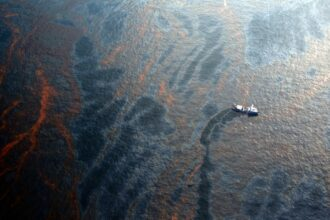 A boat works to collect oil that has leaked from the Deepwater Horizon wellhead in the Gulf of Mexico on April 28, 2010 near New Orleans, Louisiana. Credit: Chris Graythen/Getty Images