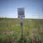 A sign marks the ground covering TransCanada's Keystone I pipeline outside of Steele City, Nebraska. The Keystone XL pipeline was set to meet the first pipeline at this location. Credit: Lucas Oleniuk/Toronto Star via Getty Images