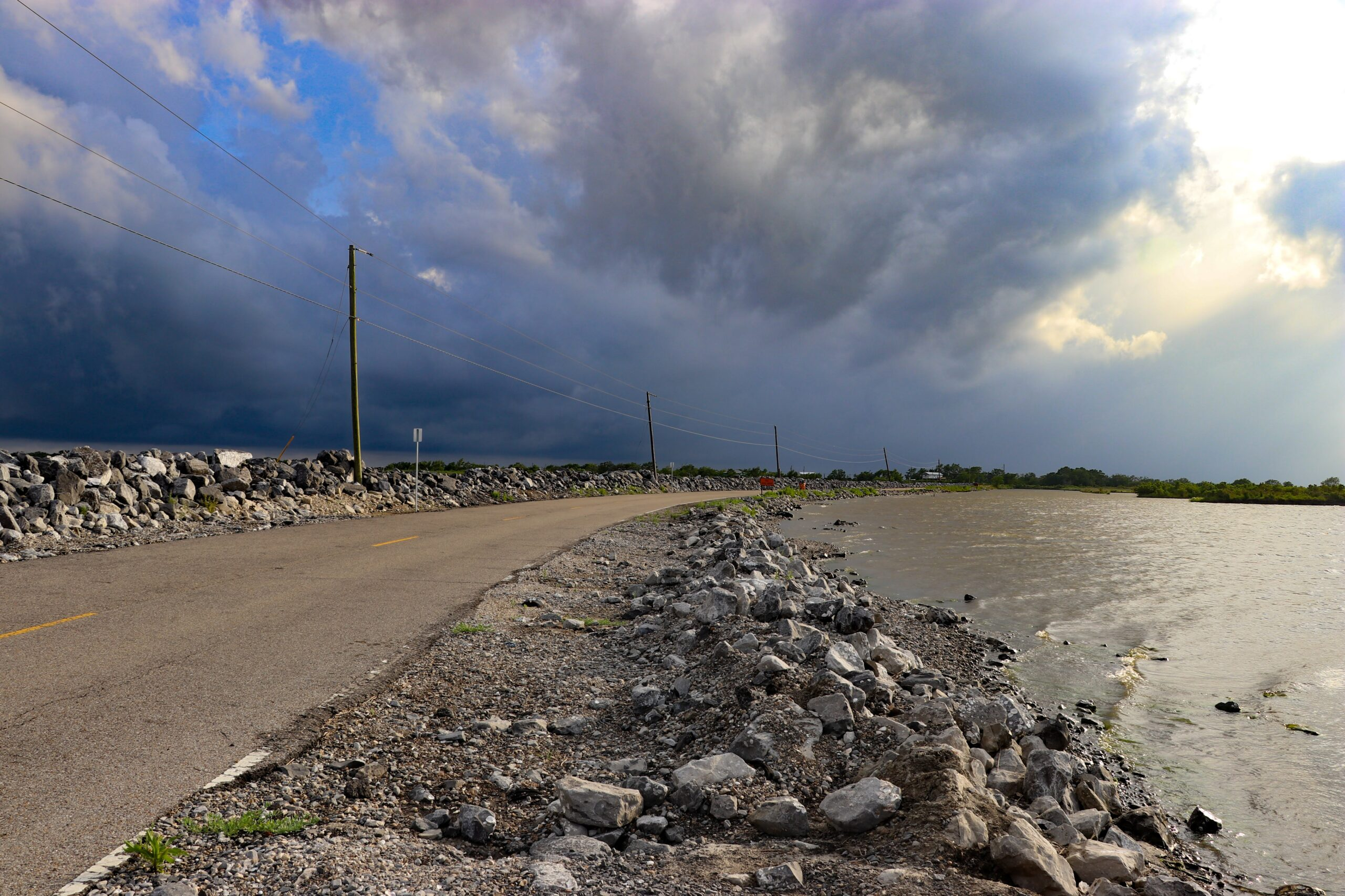 Island Road, the only road to Isle De Jean Charles, is often flooded by encroaching water leaving residents stranded on the island for hours or days at a time. Credit: Katie Livingstone/Inside Climate News