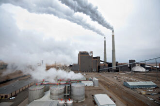 Part of the Great River Energy Blue Flint Ethanol plant stands in front of the GRE Coal Creek Station power plant in Underwood, North Dakota, U.S., on Thursday, Feb. 9, 2012. Credit: Daniel Acker/Bloomberg via Getty Images