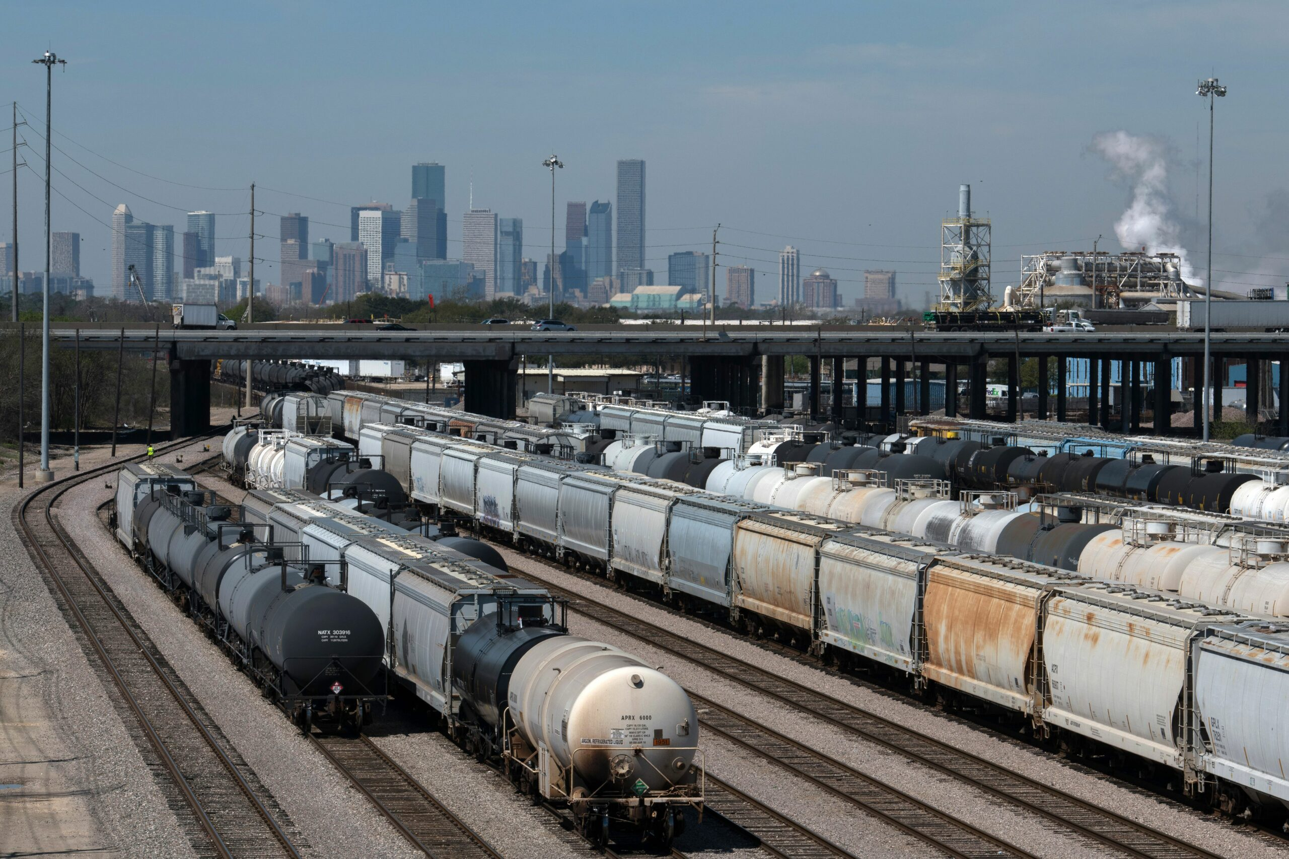 Houston's skyline, as seen from a railroad yard on the city's perimeter. Credit: Loren Elliott/ AFP via Getty Images.