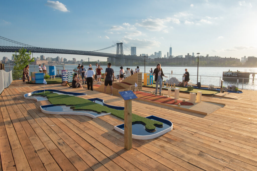 People play at the Putting Green mini golf course in Brooklyn, New York. Photo Courtesy of Two Trees Management