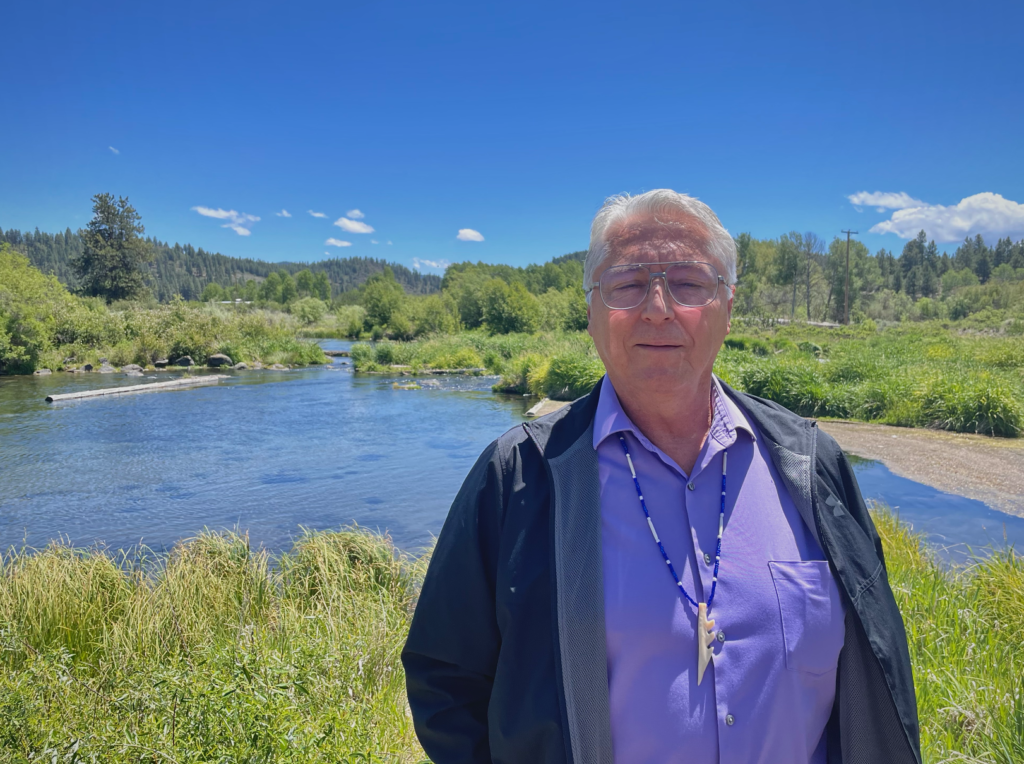 Don Gentry, chairman of the Klamath Tribes, stands near the Sprague River which flows into Upper Klamath Lake. Credit: Anne Marshall-Chalmers