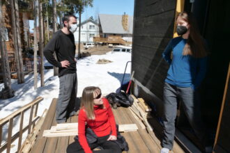 Kristen Taddonio confers with the CU Boulder students working on the home they were constructing for her and her husband in Fraser, Colorado, which was the students' 2021 Solar Decathlon entry. Credit: Casey A. Cass/University of Colorado