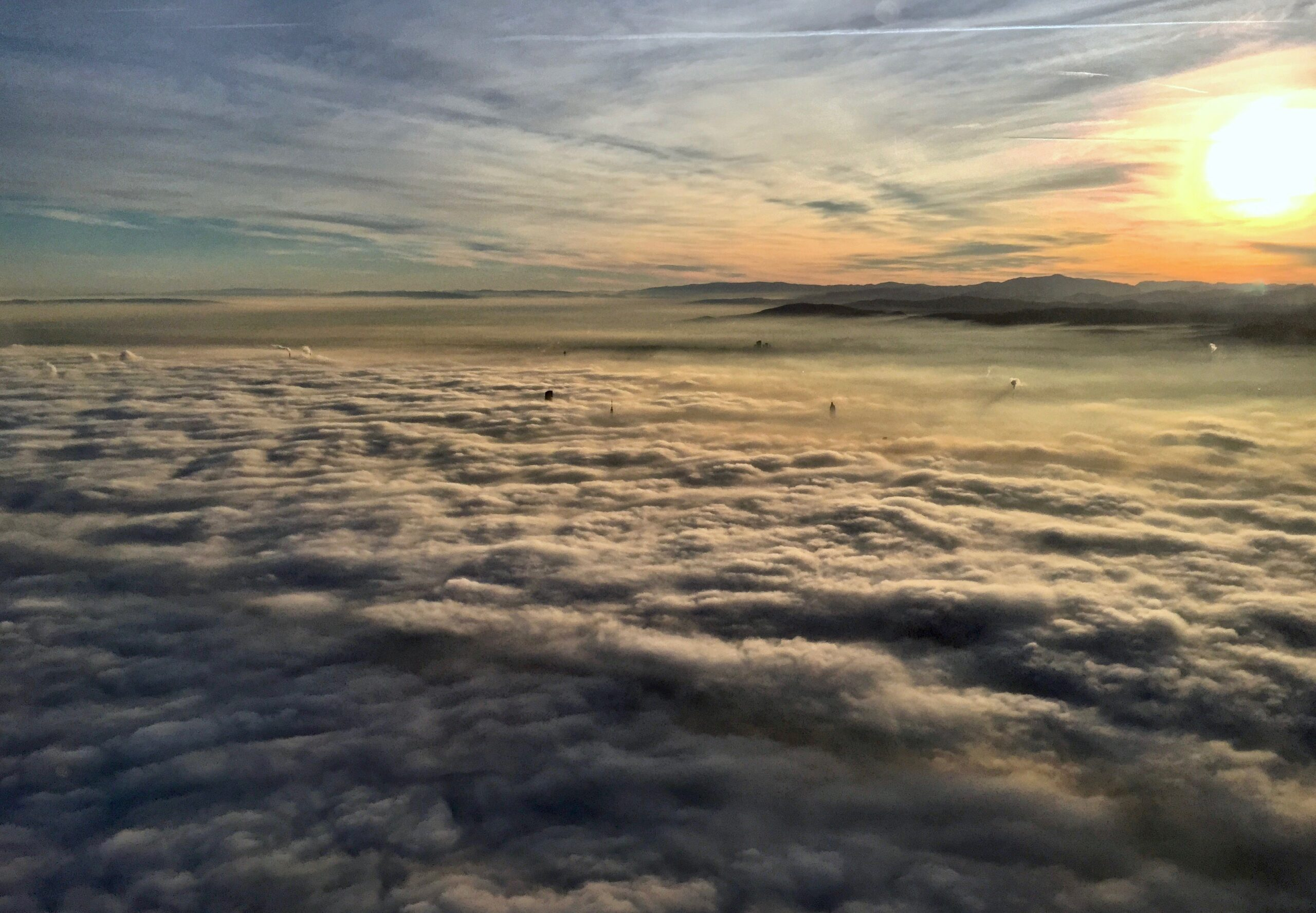 Clouds hang over Vienna, Austria. Clouds are like a blanket, cooling or heating, depending on how thick and bright they are. A new study shows global warming will change clouds in ways that will add to the temperature increase. Credit: Bob Berwyn