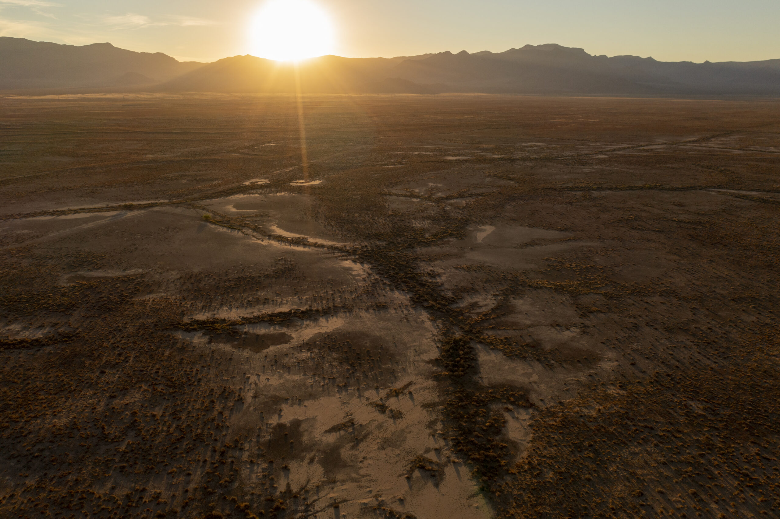 In an aerial view, polygonal blocks of giant desiccation cracks (GDCs), as geologists have dubbed them, are seen near Red Lake on June 28, 2021 north of Kingman, Arizona during an exceptional drought. Credit: David McNew/Getty Images