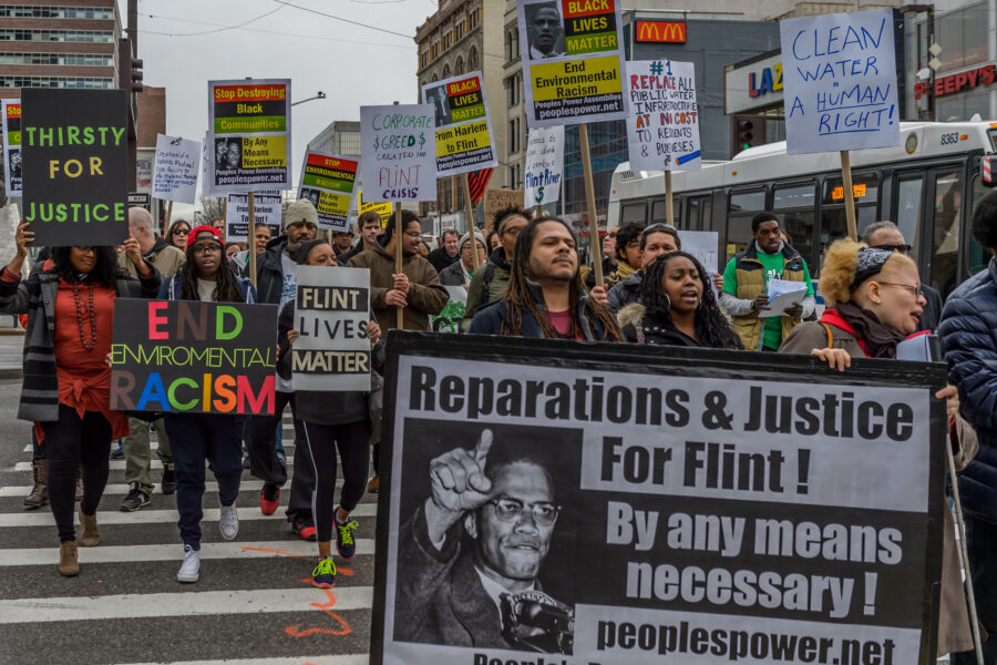 A coalition of NYC Black Lives Matter activists and environmental justice groups march on the 51st anniversary of the assassination of Malcolm X in 2016 to demand justice for the people of Flint, Michigan. Credit: Erik McGregor/LightRocket via Getty Images