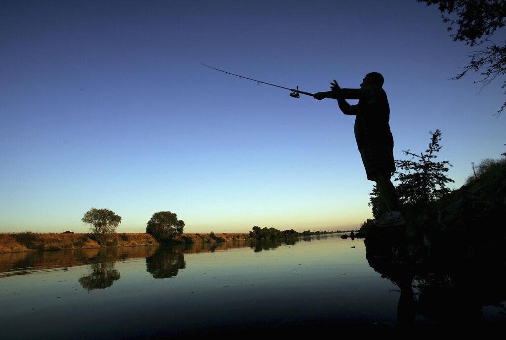 A fisherman casts his line into the Sacramento River in the Sacramento-San Joaquin River Delta on Sept. 29, 2005 south of Sacramento, California. Credit: David McNew/Getty Images
