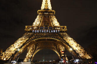 """The slogan """"For the planet"""" is projected on the Eiffel Tower as part of the World Climate Change Conference 2015 (COP21) on Dec. 11, 2015 in Paris, France. Credit: Chesnot/Getty Images"""