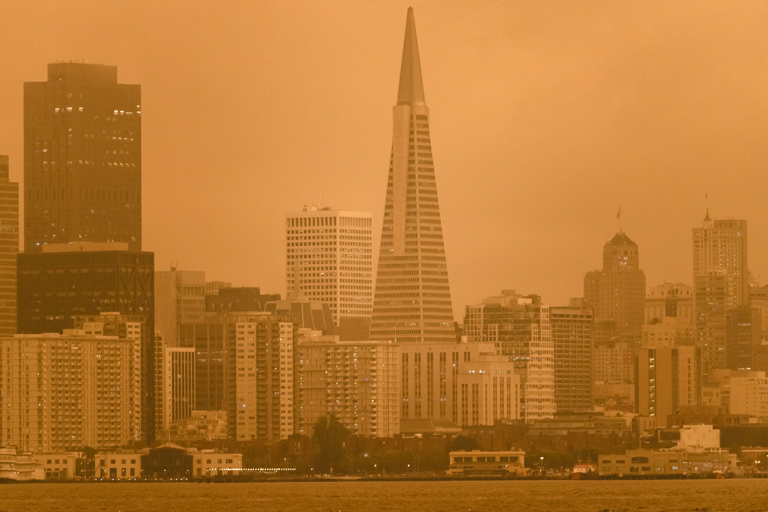 Smoke from California wildfires hangs over the San Francisco skyline in San Francisco, California, on Wednesday, Sept. 9, 2020. Credit: Michael Short/Bloomberg via Getty Images