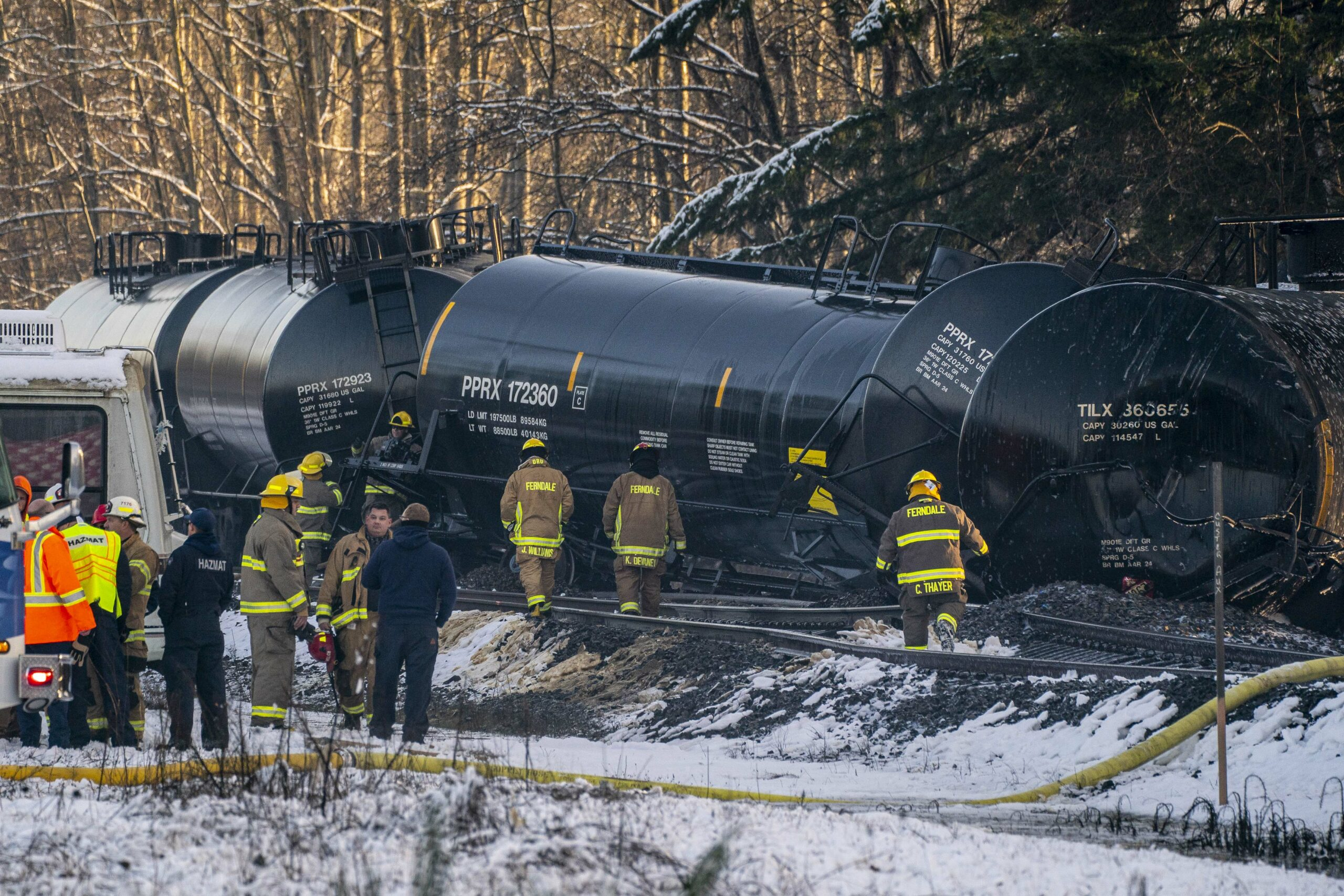 Emergency response personnel work at the scene of a derailed train carrying crude oil on Dec. 22, 2020 in Custer, Washington. Credit: David Ryder/Getty Images