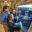 Sandia National Laboratories researchers Leo Small (back right) and Erik Spoerke (back left) observe as Martha Gross (front) works in a glovebox on a new kind of molten-sodium battery. Credit: Randy Montoya