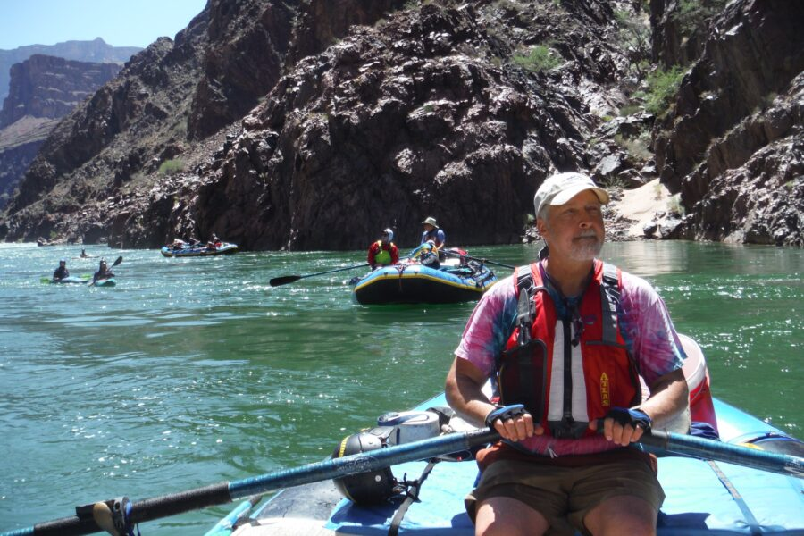 Ian McCammon, the writer's spouse, rows the Colorado River through the Grand Canyon National Park, here amidst ancient Vishnu schist in May. The trip offers a window into deep time and recent history. The needs of recreational boaters, wildlife, the canyon ecology and water users is part of an ongoing conversation that has been made more contentious because of drought, water shortages and global warming. Credit: Judy Fahys/Inside Climate News