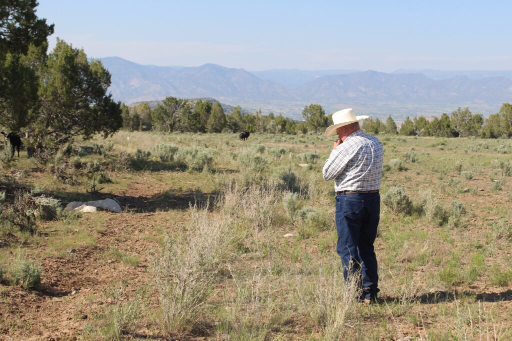Rancher Wayne Pollard stands on a ridge above Rifle, Colorado. Western Colorado, where the Colorado River begins, is experiencing some of its driest conditions on record. Credit: Luke Runyon/KUNC