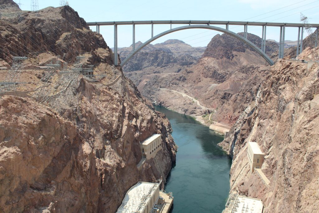 The Colorado River exits Hoover Dam on the Nevada-Arizona border. Credit: Luke Runyon/KUNC