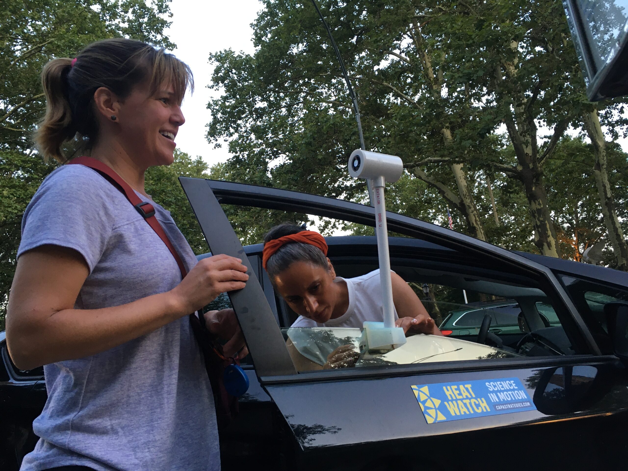 Volunteers Sarah Slack (left) and Satpal Kaur (right) prepare to drive around Northern Manhattan with a temperature and humidity sensor on July 24, 2021, as part of a campaign to map disparities in the urban heat island effect between New York City neighborhoods. Credit: Delger Erdenesanaa