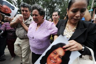 Relatives of murdered indigenous activist Berta Caceres cry on March 3, 2016. Credit: Orlando Sierra/AFP via Getty Images