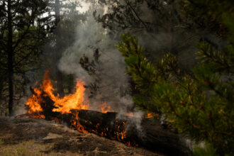 Fires smolder and burn in the mountains west of Paisley, Oregon. Credit: Maranie Staab/Bloomberg via Getty Images