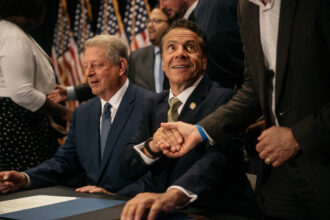 Former Vice President Al Gore joins New York Governor Andrew Cuomo as he signs the Climate Leadership and Community Protection Act at Fordham Law School in the borough of Manhattan on July 18, 2019 in New York City. Credit: Scott Heins/Getty Images
