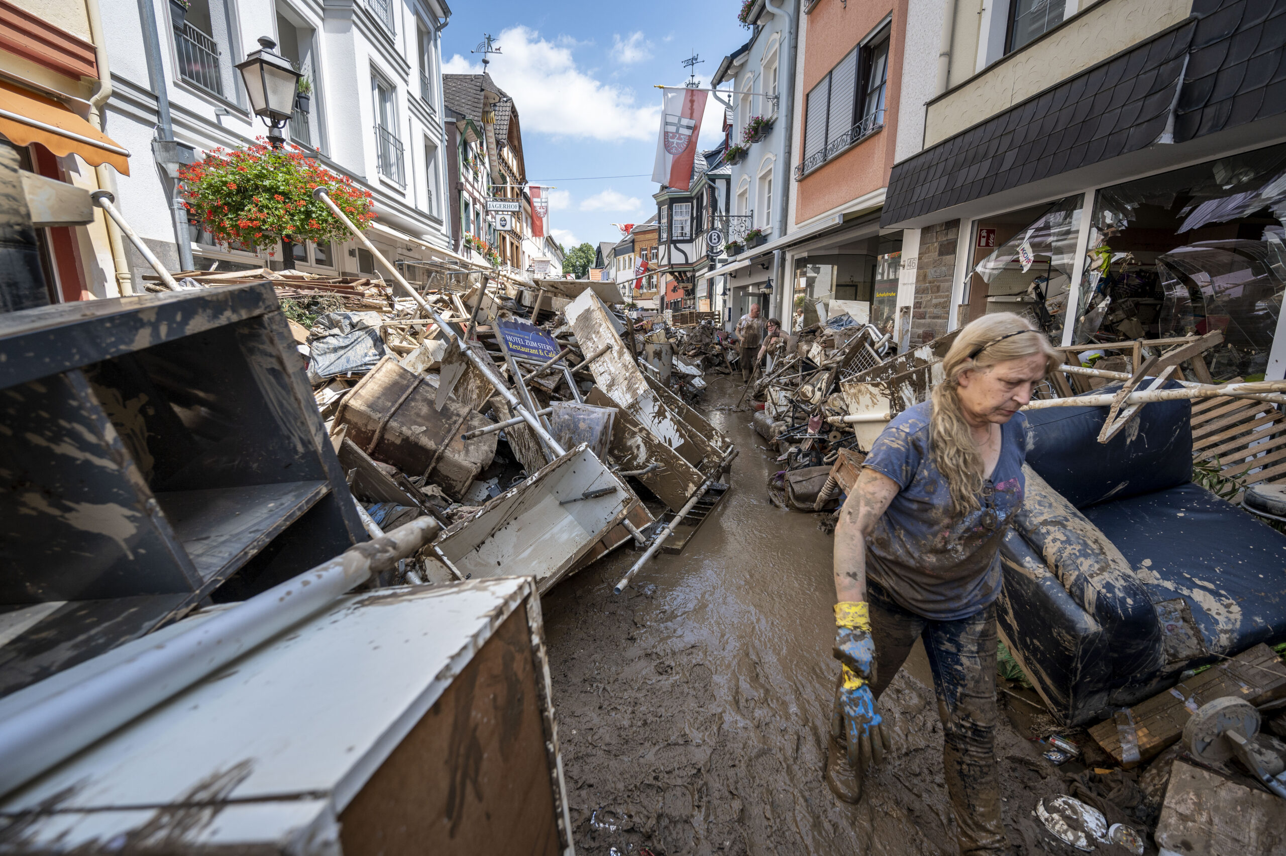 Volunteers and residents start the clean up process at their shops and restaurants following severe flash flooding on July 18, 2021 in Bad Neuenahr-Ahrweiler, Germany. Credit: Thomas Lohnes/Getty Images