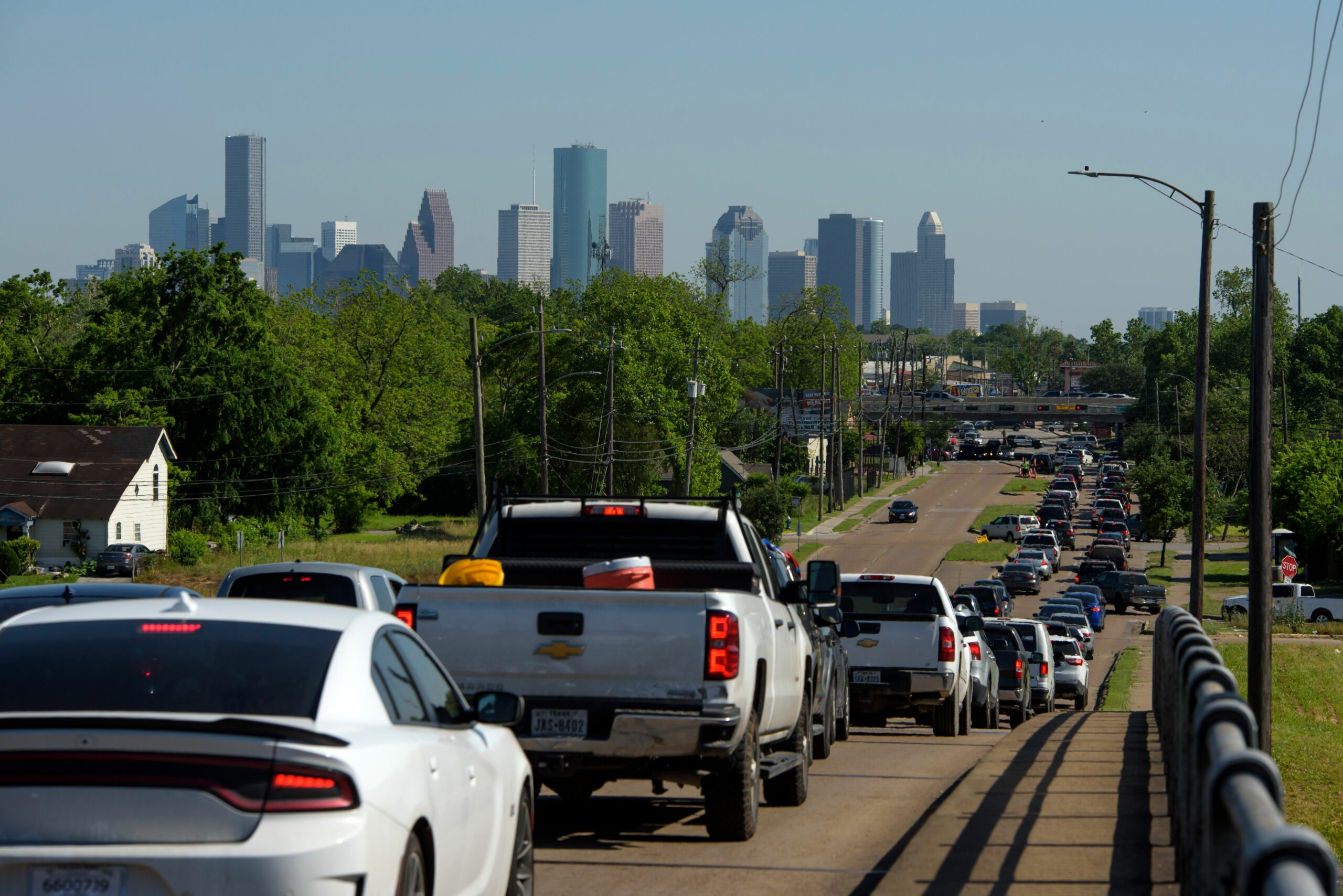 Cars are lined up in traffic on Airline Drive after a food distribution site at Reyes Produce opened on April 13, 2020 in Houston, Texas. Credit: Mark Felix / AFP via Getty Images