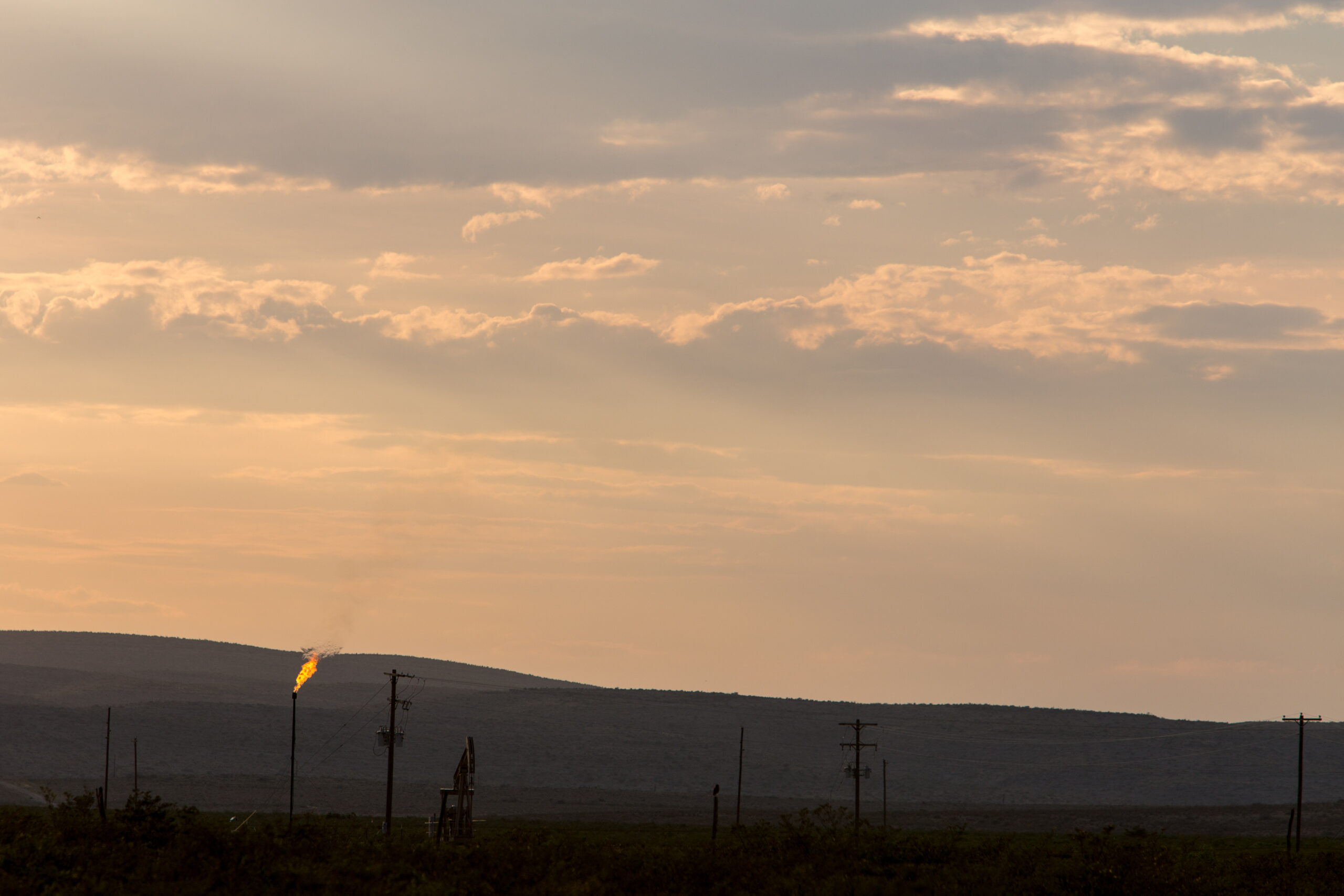 Methane gas is flared just off U.S. Route 285 near Carlsbad, New Mexico, on Tuesday, Aug. 6. 2019. Credit: Steven St John/Bloomberg via Getty Images