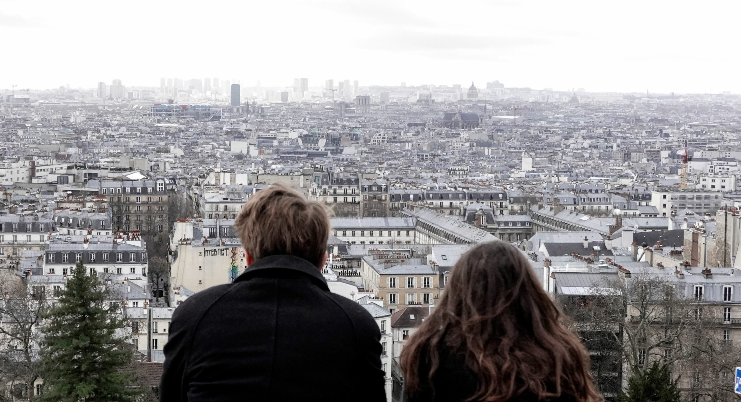 A couple look at Paris skyline from the Montmartre area in Paris, on March 15, 2020. Credit: Stefano Rellandini/AFP via Getty Images