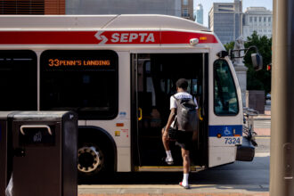 A commuter boards a SEPTA bus in Philadelphia, Pennsylvania, on Friday, July 30, 2021. Credit: Hannah Beier/Bloomberg via Getty Images