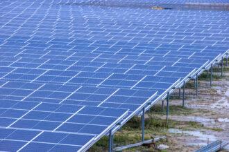 A solar park is being built in a former opencast gravel mine. Credit: Jens Büttner/picture alliance via Getty Images