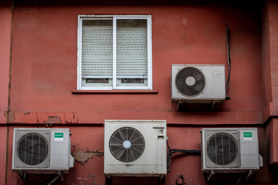 Air conditioning units on the exterior of a residential apartment building in Barcelona, Spain, on Thursday, July 29, 2021. Credit: Angel Garcia/Bloomberg via Getty Images