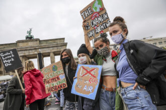 """Climate activists gather on a """"Global Day of Action"""" organized by the 'Fridays for Future' climate change movement during the coronavirus pandemic on Sept. 25, 2020 in Berlin, Germany. Credit: Omer Messinger/Getty Images"""
