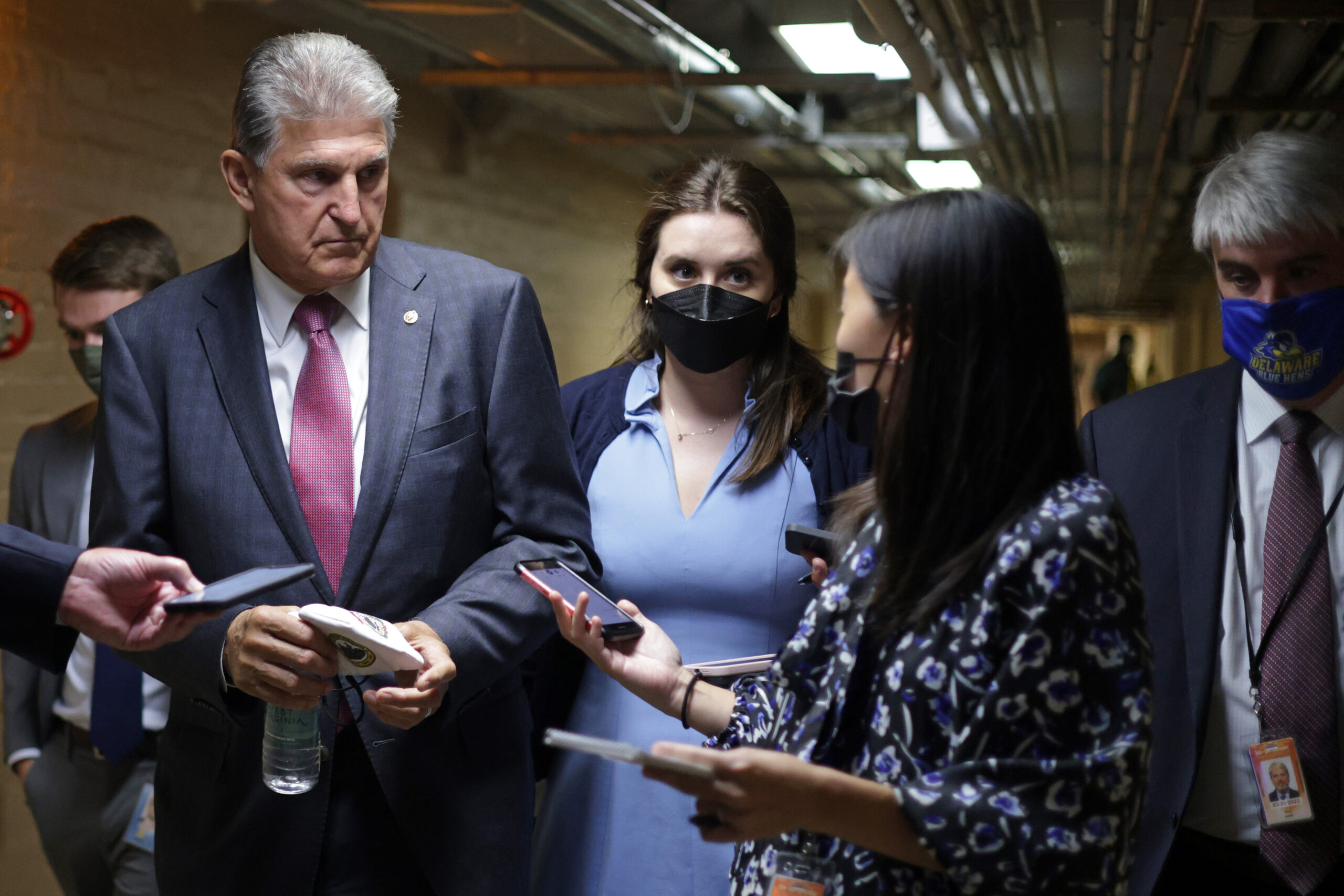 Sen. Joe Manchin (D-W.Va.) talks to members of the press in a hallway at the U.S. Capitol Sept. 28, 2021 in Washington, D.C. Credit: Alex Wong/Getty Images