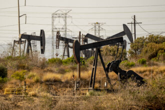 Oil pump jacks operate at the Inglewood Oil Field in Culver City, California, on July 11, 2021. Credit: Kyle Grillot/Bloomberg via Getty Images