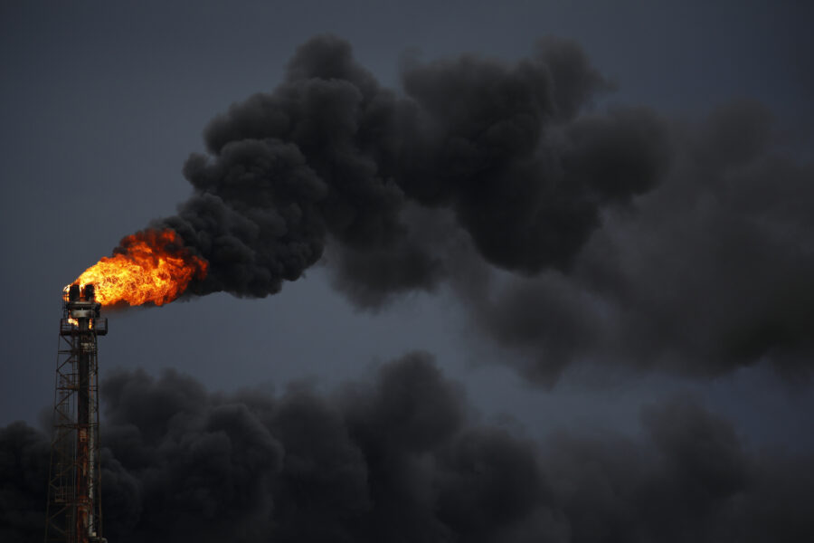 An oil flare burns at the Royal Dutch Shell Norco Refinery during a power outage caused by Hurricane Ida in LaPlace, Louisiana, on Monday, Aug. 30, 2021. Credit: Luke Sharrett/Bloomberg via Getty Images